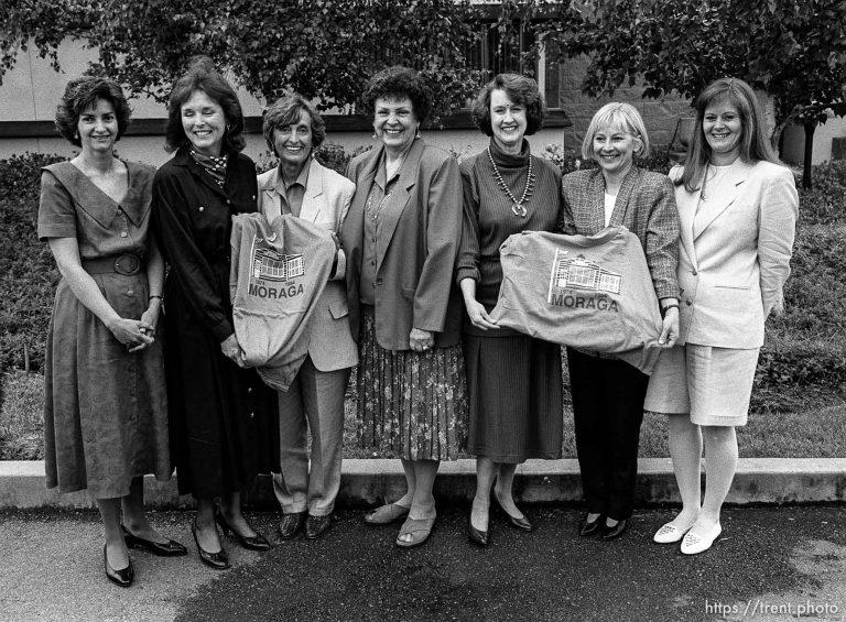 Women holding shirts